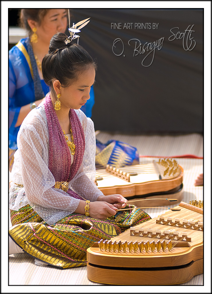 Woman Playing the Khim